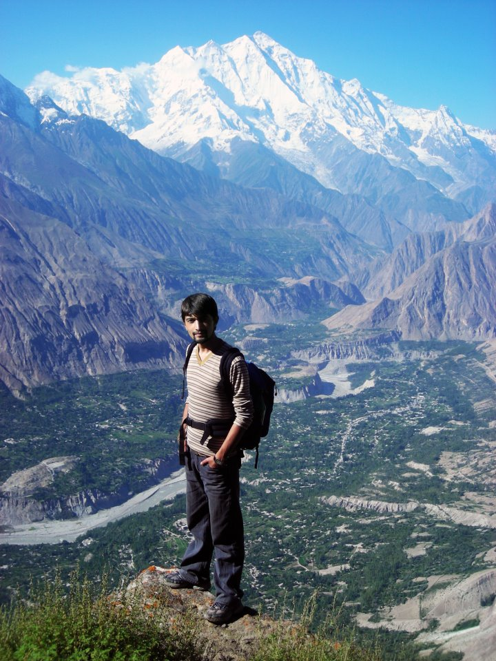 Imran Hunzai on Hon Pass Hunza Valley. Beautiful Rakaposhi can also bee seen in the background.